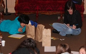 Teresa Klepinger, Young WW Director, leading a group of young writers in a writing activity